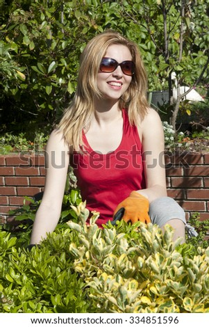 Lady gardner on work  - stock photo