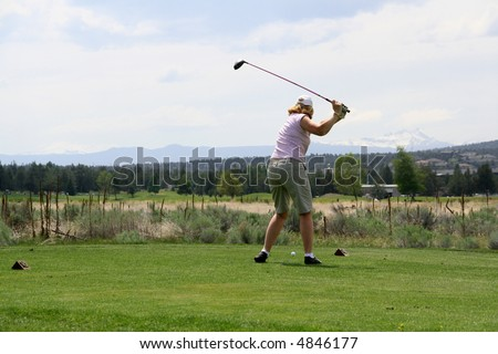 Lady golfer hitting ball from tee,		Eagle Crest Resort Golf Course,	Central Oregon