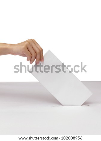 Lady hand putting a voting ballot in slot of white box isolated on white - stock photo