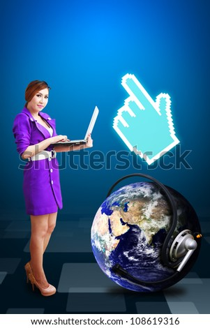 Lady hold laptop and digital hand : Elements of this image furnished by NASA