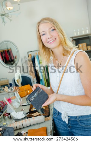 Lady holding purse in a store - stock photo