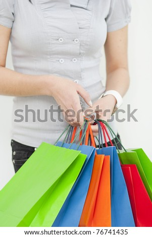 Lady holds gift bags - stock photo