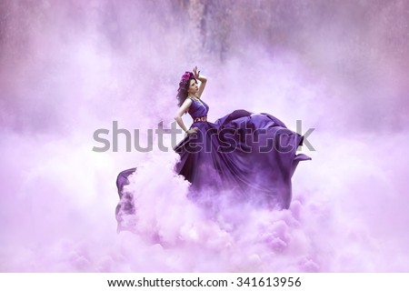 Lady in a luxury lush purple dress swirls in the smoke,fantastic shot,fairytale princess is walking in the autumn forest,fashionable toning,creative computer colors - stock photo