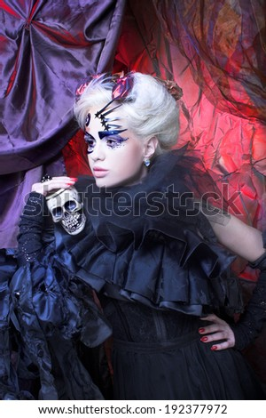Lady in black. Young woman in creative magic image. - stock photo