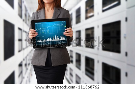 Lady in data center room and graph report - stock photo