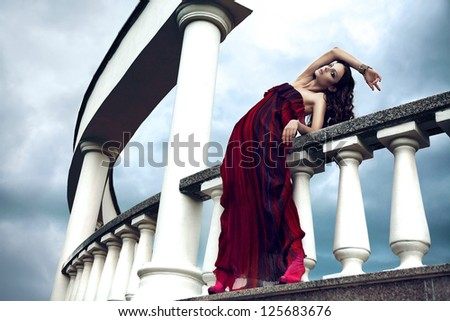 Lady in red - stock photo