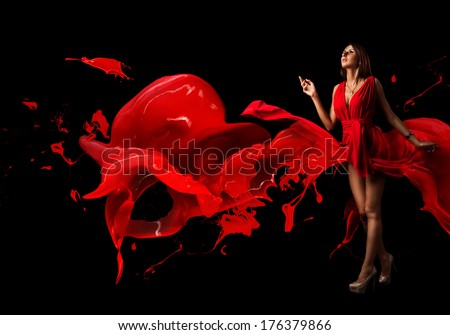 Lady in red. Beautiful woman covered in red dress on a dark background. Dress clothes from paint. Spray paint in the form of a broken heart of love. Production of paints and varnishes. Space for text. - stock photo