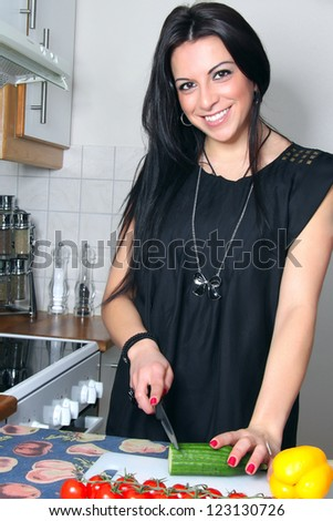 Lady in the kitchen - stock photo
