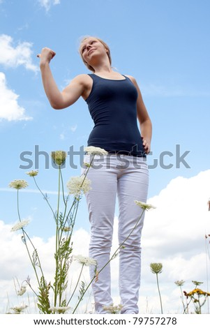 Lady is hitchhiking - stock photo