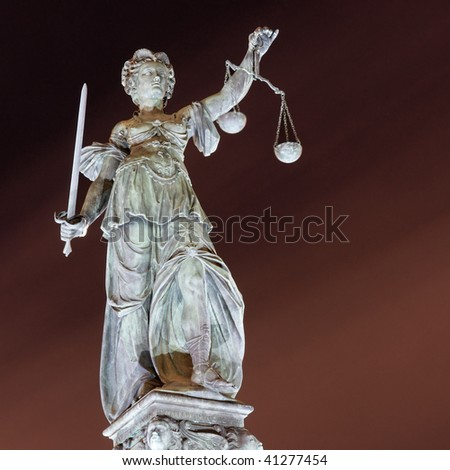 Lady Justice by night in Frankfurt. Germany. - stock photo