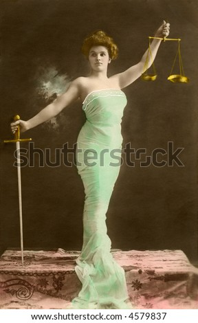 Lady Justice - circa 1915 vintage hand-tinted staged photo - stock photo