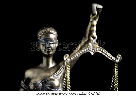 Lady Justice in black background - stock photo