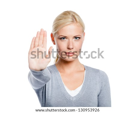 Lady making stop gesture with her palm, isolated on white - stock photo