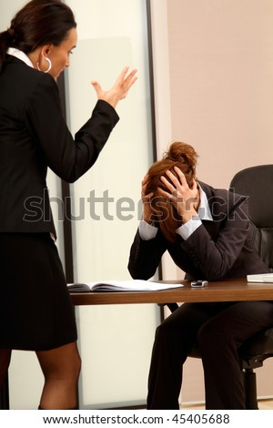 Lady Manager screaming to her superior - stock photo