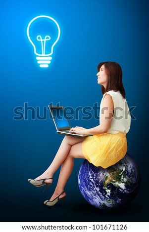 Lady on globe got idea : Elements of this image furnished by NASA - stock photo