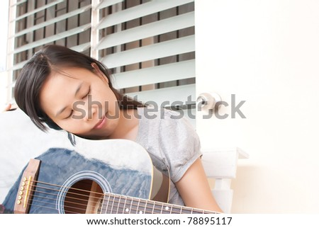 Lady playing classic acoustic guitar. - stock photo