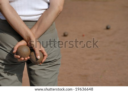 Lady playing jeu de boules in France - stock photo