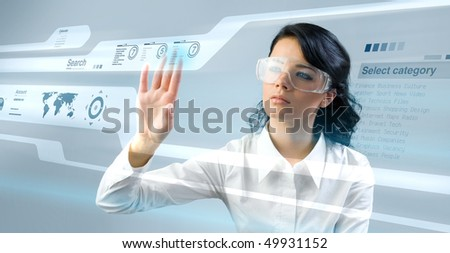 Lady press touch interface in virtual space. Future business technology series. (outstanding business people in interiors / interfaces series) - stock photo