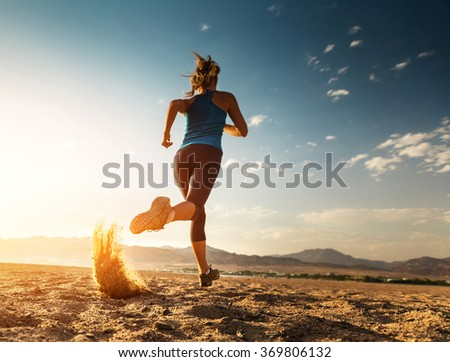 Lady running in the desert - stock photo