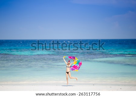 Lady sexy in bikini. She walk on the beach Tachai island in Thailand. She feeling happy and relax. The day is clear sky in summer. - stock photo