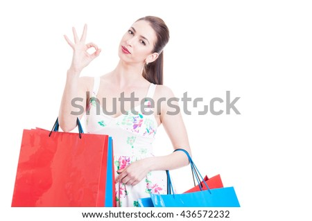 Lady shopper with summer look showing okay gesture concept isolated on white background with copy advertising area