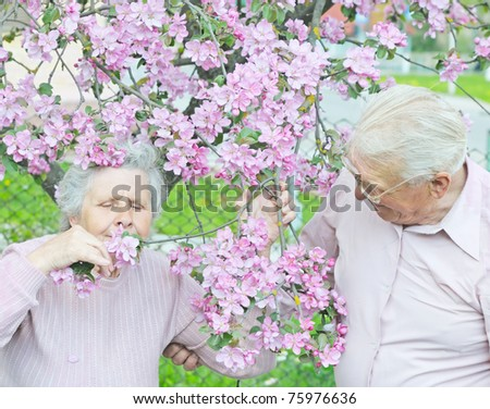 lady smell flower and near hear stay husband - stock photo