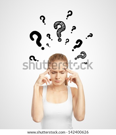 lady standing thinking with question mark over head - stock photo