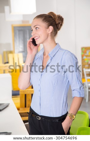 Lady talking on mobile phone. Businesswoman at workplace. Portrait beautiful woman on the background of modern business office. Young business woman working in office.  - stock photo