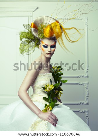 Lady with avant-garde hair and bright make-up - stock photo