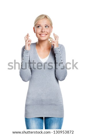 Lady with fingers crossed, isolated on white. Concept of wishing or praying about something - stock photo