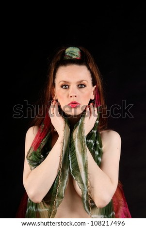 Lady with green and red silk scarf tied around her head - stock photo