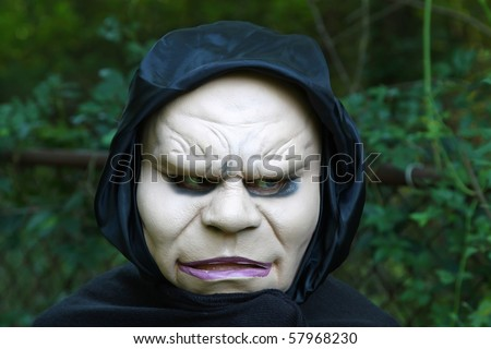 lady with mask on scaring all the neighbors on halloween - stock photo