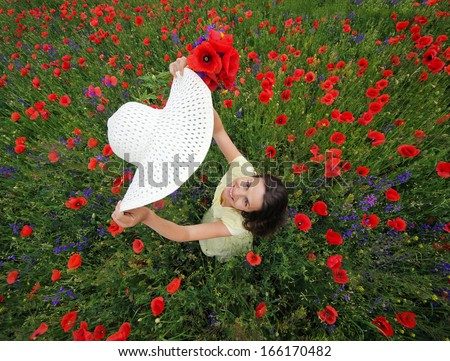 Lady with white hat and poppies bunch - stock photo