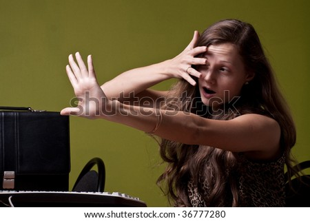 Ladyy looking at awful pictures - stock photo