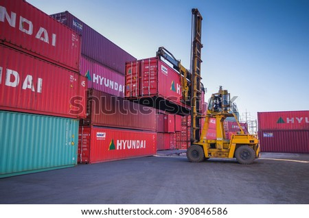 LAEM CHABANG -MARCH 10 : Containers transfer within yard at Laem Chabang commercial port on March 10, 2016 in Laem Chabang, Thailand - stock photo