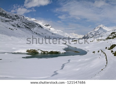 Lago Bianco is a lake at the Bernina pass in the Grisons, Switzerland. - stock photo