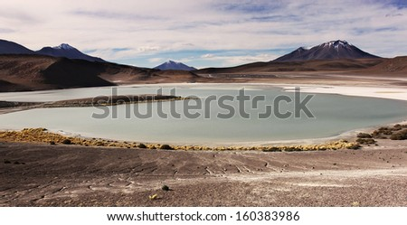 Lagoon on the boarders of Argentina Chile and Bolivia/Mountains on borders/Uyuni salar flat near Potosi - stock photo