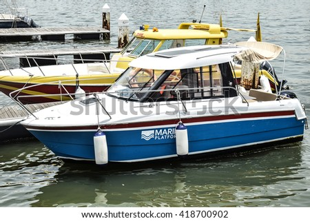 LAGOS, NIGERIA -  APRIL 5, 2016 : Tourists Boats at the dock.
