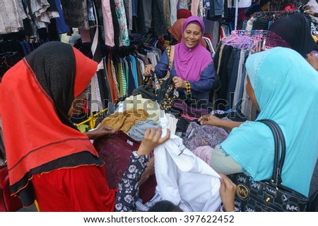 Lahad Datu Sabah Malaysia - Mar 27, 2016 : People shoping for used cloth at market called Tamu in Lahad Datu Sabah. Used clothes mostly imported from country like Japan and sold at cheap price.