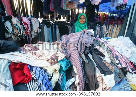 Lahad Datu Sabah Malaysia - Mar 27, 2016 : Used clothes on display for sale at market called Tamu in Lahad Datu Sabah. Used clothes mostly imported from country like Japan and sold at cheap price.