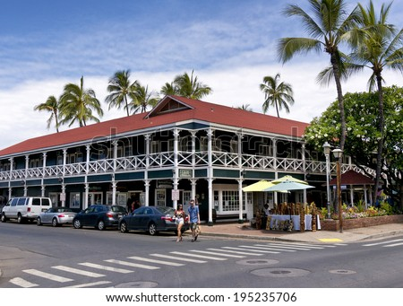 LAHAINA, HI - MAY 22: The Pioneer Inn on the Lahaina, Maui waterfront on May 22, 2014. The Pioneer Inn was built in 1901 and or a long time, the Pioneer Inn was the only hotel in Lahaina. - stock photo