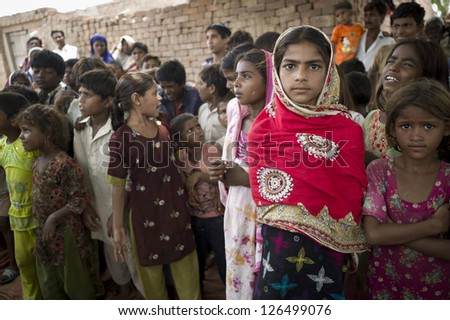 LAHORE, PAKISTAN- AUG 2: Unidentified children in brick kiln are waiting for the food from relief team on August 2 2012 in Lahore, Pakistan. - stock photo