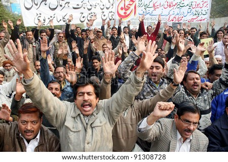 LAHORE, PAKISTAN, DEC 21: Members of All Pakistan Clerks Association (APCA) shout slogans in favor of their demands during a protest demonstration at Lahore press club on December 21, 2011. - stock photo