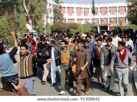 LAHORE, PAKISTAN, DEC 22: Punjab University (PU) students protest in favor of their demands during demonstration after clash between two students groups on December 22, 2011 in Lahore. - stock photo