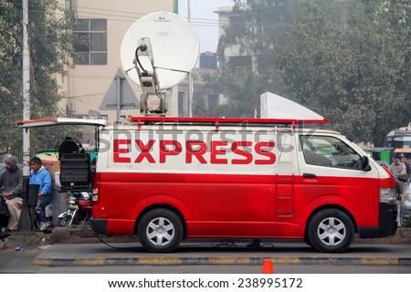 LAHORE, PAKISTAN - DECEMBER 18: Express News Digital Satellite News Gathering DSNG Van Parked for Coverage of News Events in Lahore, Pakistan on December 18, 2014 - stock photo