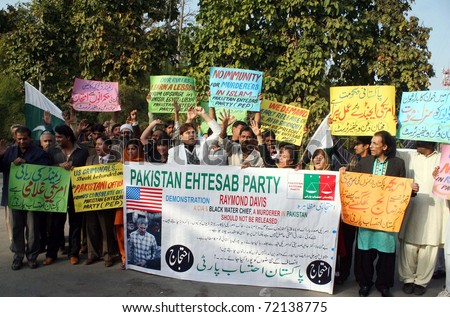 LAHORE, PAKISTAN - FEB 27: Activists of Ehtesab Party (PEP) chant slogans against Raymond Davis and in favor of their demands during a protest demonstration on February 27, 2011in Lahore. - stock photo