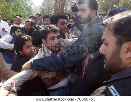 LAHORE, PAKISTAN - FEB 09: View of clash between students of  Punjab University and police officials during protest demonstration of students in favor of their  demands on February 09, 2011 in Lahore. - stock photo