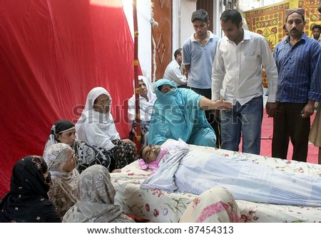 LAHORE, PAKISTAN - OCT 26: A railways pensioner who was lost his life while waiting outside a bank branch whole night for his turn to get his pension on  October 26 ,2011in Lahore