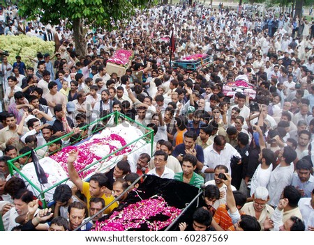 LAHORE, PAKISTAN-SEPT 02: People carry coffins of those who were lost their  life in bomb explosions yesterday, for burial after  funeral prayer at Nasir Bagh in  Lahore on Sept 2, 2010