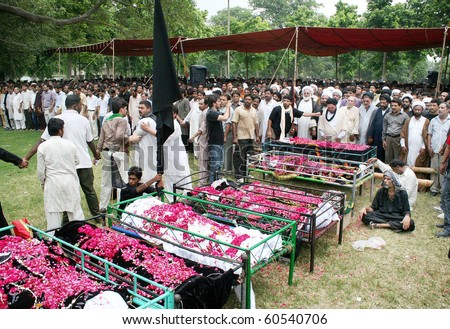 LAHORE, PAKISTAN-SEPT 02: People offer funeral prayer of those, who were lost their  life in bomb explosions yesterday, at Nasir Bagh on Thursday, September 02, 2010 in Lahore.